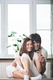 Beautiful girl with phone and boy Stock Photography