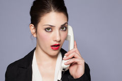 Beautiful girl at the phone Stock Images