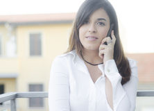 Beautiful girl on the phone outdoor Stock Image