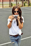 Beautiful girl photographer with old camera Stock Photography