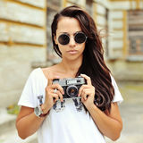 Beautiful girl photographer with old camera Stock Photo