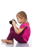 Beautiful girl photographing Stock Images