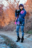 Beautiful girl photographing in cold weather. Girl photographing outside in a cold weather Royalty Free Stock Photo