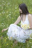 Beautiful girl picking flowers Royalty Free Stock Images