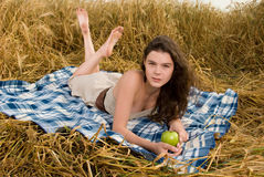 Beautiful girl on picnic with apple Stock Image