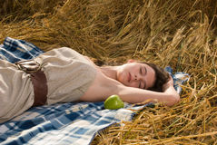 Beautiful girl on picnic with apple Royalty Free Stock Photo