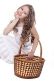 Beautiful girl with picnic basket over white Stock Photography