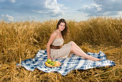 Beautiful girl on picnic with fruts Royalty Free Stock Photos