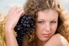 Beautiful girl on picnic with grapes Royalty Free Stock Photos