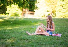 Beautiful girl on a picnic in park Royalty Free Stock Photo