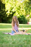 Beautiful girl on a picnic in park Stock Image