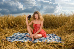 Beautiful girl on picnic in wheat field Stock Images