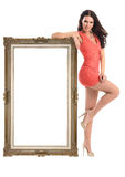 Beautiful girl with  picture frame  isolated on white Royalty Free Stock Photography