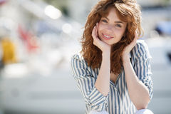 Beautiful girl on the pier next to the yacht club Stock Photography