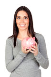 Beautiful girl with piggy-bank Royalty Free Stock Images