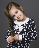 Beautiful girl with pigtails and blue eyes Stock Photography