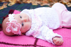 Beautiful girl in a pink baby clothes Stock Photo