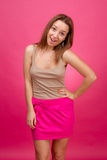 Beautiful girl on a pink background. Royalty Free Stock Images