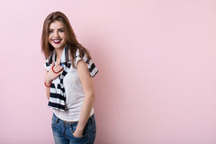 Beautiful girl on a pink background wall Stock Photography