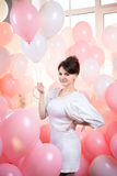 Beautiful girl in  pink balloons Royalty Free Stock Photo