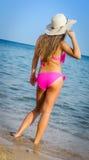 Beautiful girl in pink bikini Stock Photography