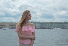 Beautiful girl in a pink blouse near the river. Stock Photography
