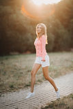 Beautiful girl in a pink blouse Royalty Free Stock Photos
