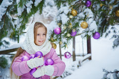 Beautiful girl in a pink coat and white scarf Stock Photo