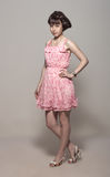 Beautiful girl in a pink dress Stock Image