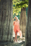 Beautiful girl in a pink dress in the forest Stock Photography