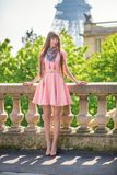 Beautiful girl in pink dress near the Eiffel tower Royalty Free Stock Images
