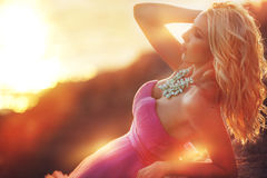 Beautiful girl in a pink dress on the ocean in a pink dress royalty free stock images