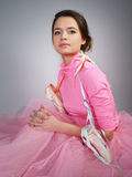 Beautiful girl in a pink dress with pointes Stock Photos