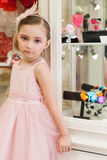 Beautiful girl in a pink dress in the shop Royalty Free Stock Photography