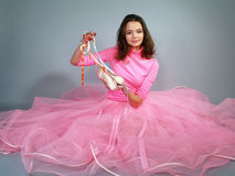 The beautiful girl in a pink dress shows pointes Stock Photos