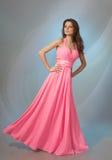 Beautiful girl in pink evening dress Stock Photo