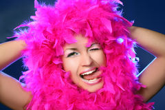 Beautiful girl in pink feathers Stock Image