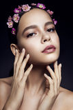 Beautiful girl with pink flowers Royalty Free Stock Photography