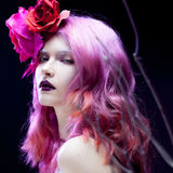 Beautiful girl with pink hair,  among the branches Royalty Free Stock Images