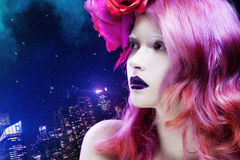 Beautiful girl with pink hair,  profile against Stock Images