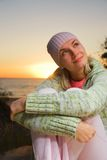 Beautiful girl in pink hat. Near the sea at sunset time Royalty Free Stock Images