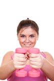 Beautiful girl in pink holding weight for exercise Stock Images