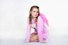 The beautiful girl in a pink jacket with wings Royalty Free Stock Photos