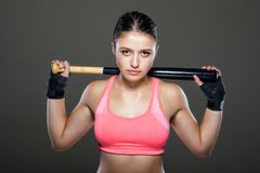Girl with a baseball bat. Beautiful girl in pink outfit, holding baseball bat Stock Images