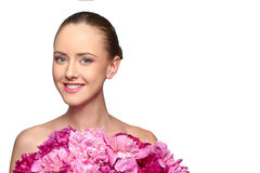 Beautiful girl with pink peony flowers Royalty Free Stock Photo