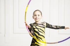 Beautiful girl with Pink Rhythmic gymnastics hoop Stock Photo
