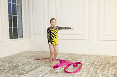 Beautiful girl with Pink Rhythmic gymnastics ribbon Stock Photography