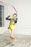 Beautiful girl with Pink Rhythmic gymnastics ribbon Stock Images