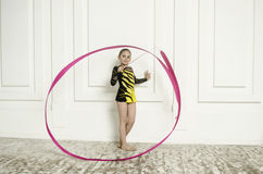 Beautiful girl with Pink Rhythmic gymnastics ribbon Royalty Free Stock Image