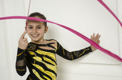 Beautiful girl with Pink Rhythmic gymnastics ribbon Royalty Free Stock Photography